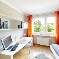 The writing desk with shelves and a chair. Come and have a look at the show apartments.
