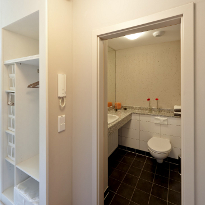 Show apartment: the built-in cupboard and the bathroom with granite wash basin and a big mirror.